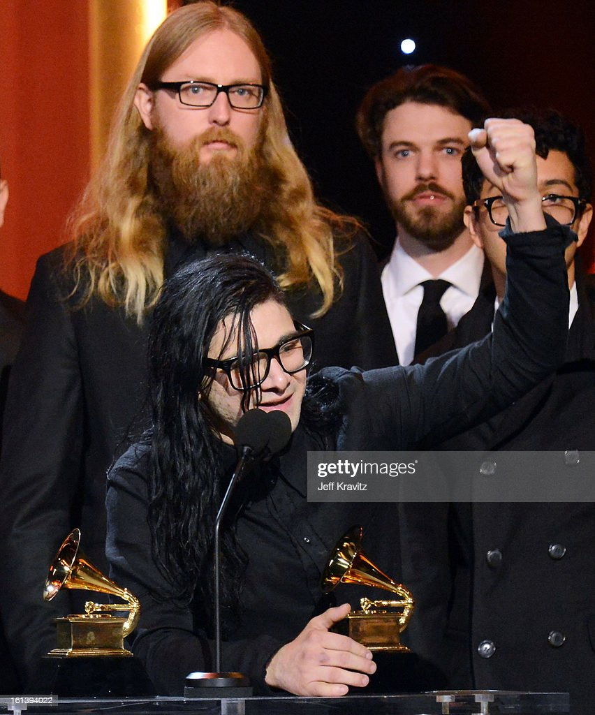 DJ/producer <a gi-track='captionPersonalityLinkClicked' href=/galleries/search?phrase=Skrillex&family=editorial&specificpeople=7574565 ng-click='$event.stopPropagation()'>Skrillex</a> accepts an award onstage during the 55th Annual GRAMMY Awards at Nokia Theatre L.A. Live on February 10, 2013 in Los Angeles, California.