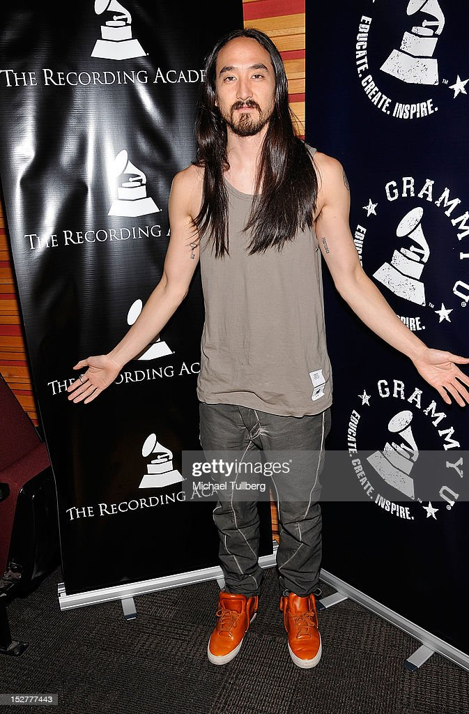 Producer <a gi-track='captionPersonalityLinkClicked' href=/galleries/search?phrase=Steve+Aoki&family=editorial&specificpeople=732001 ng-click='$event.stopPropagation()'>Steve Aoki</a> arrives at an 'Up Close & Personal with <a gi-track='captionPersonalityLinkClicked' href=/galleries/search?phrase=Steve+Aoki&family=editorial&specificpeople=732001 ng-click='$event.stopPropagation()'>Steve Aoki</a> and Kaskade' Q&A session for GRAMMY U Los Angeles at Los Angeles Film School on September 25, 2012 in Los Angeles, California.