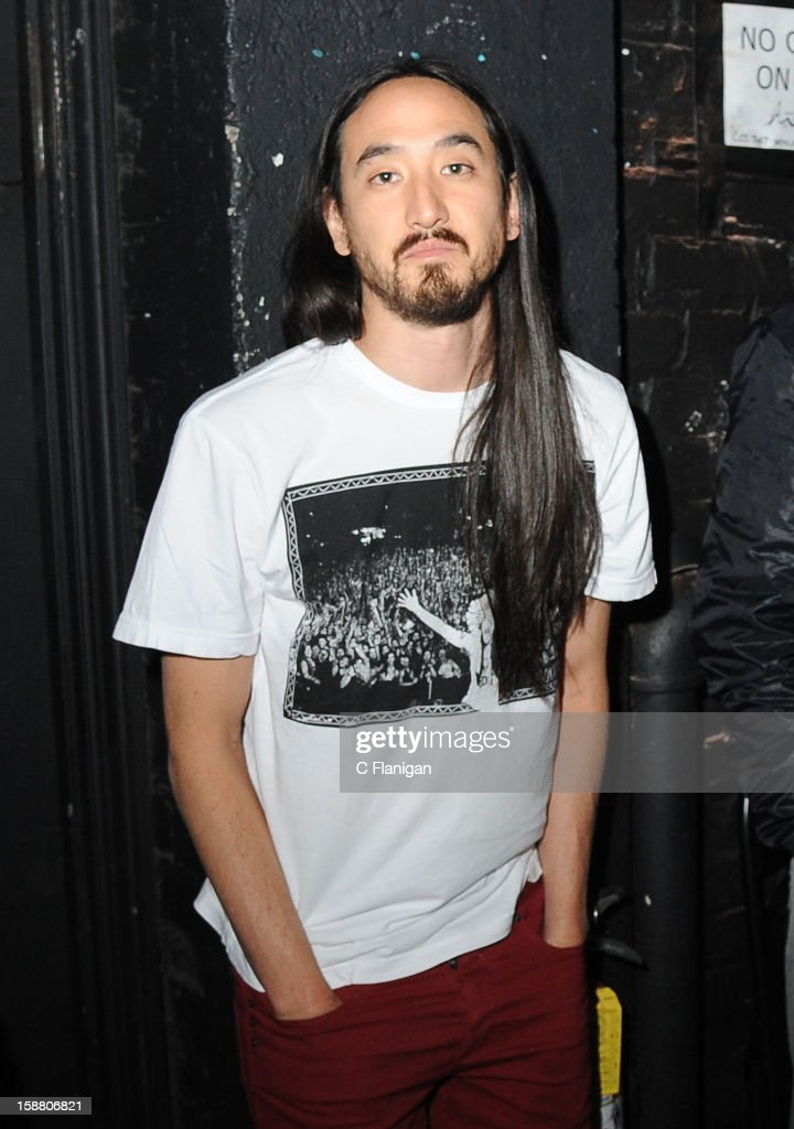 DJ/Producer Steve Aoki poses backstage at The Warfield Theater on December 29, 2012 in San Francisco, California.