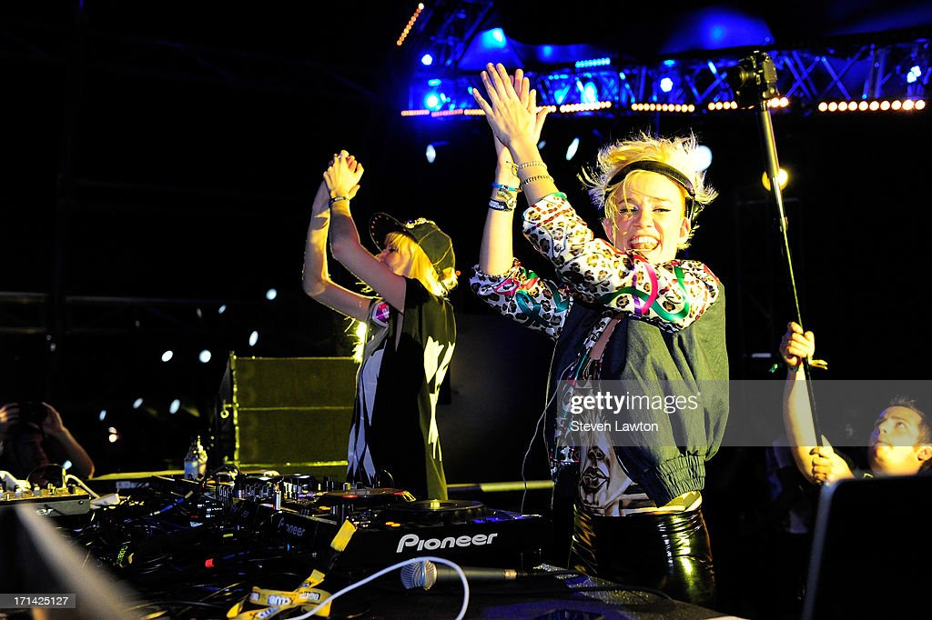DJ/producers Olivia Nervo (L) and Miriam Nervo of Nervo perform at the 17th annual Electric Daisy Carnival at Las Vegas Motor Speedway on June 23, 2013 in Las Vegas, Nevada.