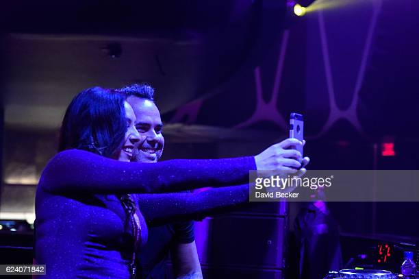 DJ/recording artist Juan Magan takes a selfie with fan at the after party for the 17th annual Latin Grammy Awards at Hakkasan Las Vegas Restaurant...