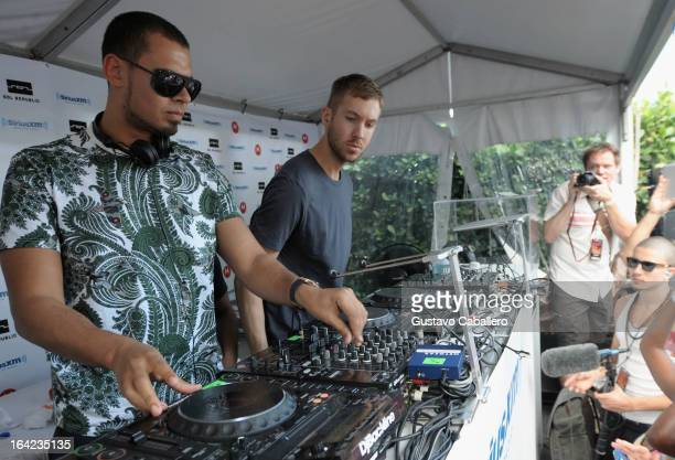 DJs Afrojack and Calvin Harris perform live on SiriusXM's 'UMF Radio' at the SiriusXM Music Lounge at W Hotel on March 21 2013 in Miami Florida