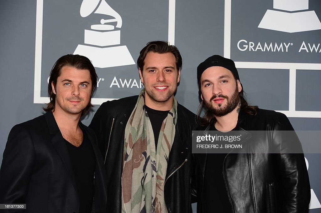 DJs Axwell (L), Steve Angello (C) and Sebastian Ingrosso of Swedish House Mafia arrives at the Staples Center for the 55th Grammy Awards in Los Angeles, California, February 10, 2013. AFP PHOTO Frederic J. BROWN