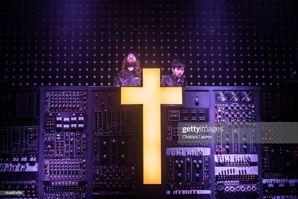 DJs Gaspard Auge (L) and Xavier de Rosnay of Justice perform during the 2012 Voodoo Experience at City Park on October 27, 2012 in New Orleans, Louisiana.
