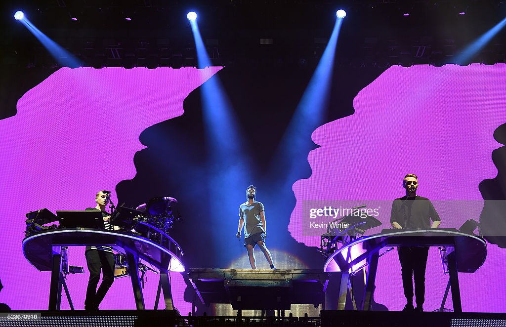 DJs Guy Lawrence (L) and Howard Lawrence of Disclosure and singer Kwabs performs onstage during day 2 of the 2016 Coachella Valley Music & Arts Festival Weekend 2 at the Empire Polo Club on April 23, 2016 in Indio, California.