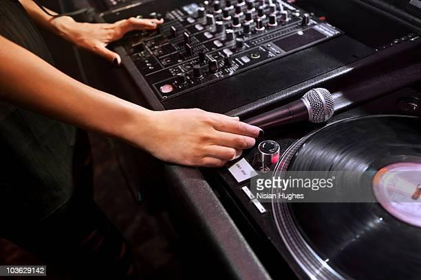 DJs hands spinning at nightclub