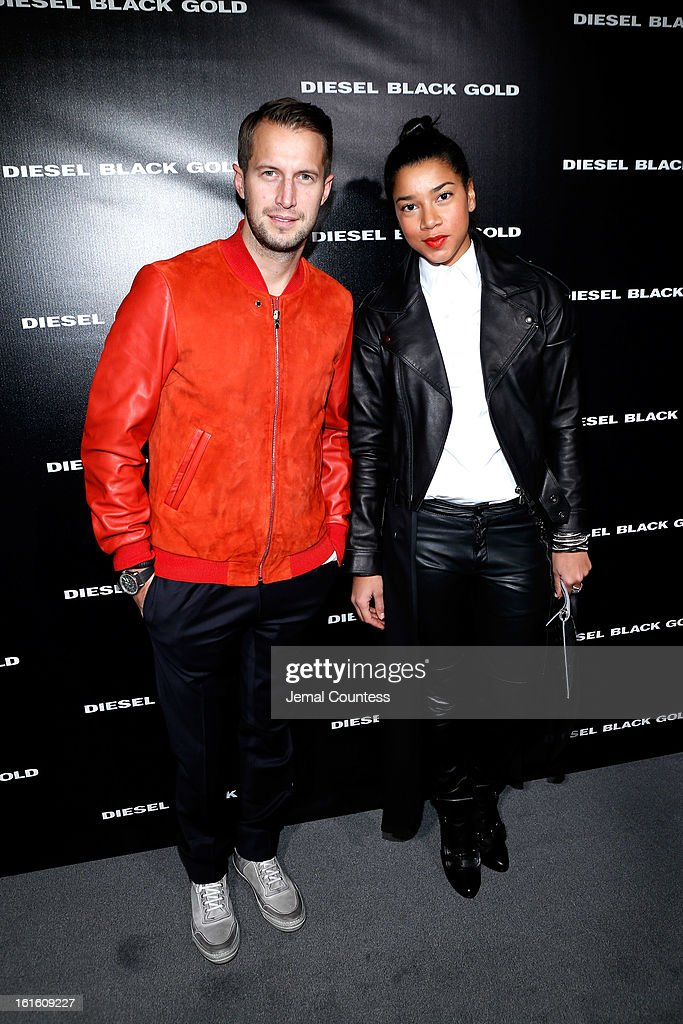 DJs Hannah Bronfman (R) and Brendan Fallis pose backstage at the Diesel Black Gold Fall 2013 fashion show during Mercedes-Benz Fashion Week at Pier 57 on February 12, 2013 in New York City.