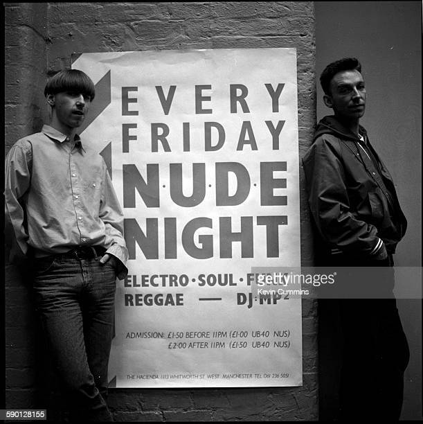 DJs Martin Prendergast and Mike Pickering aka MP2 with a poster advertising 'Nude Night' their Friday night house music set at the Hacienda nightclub...