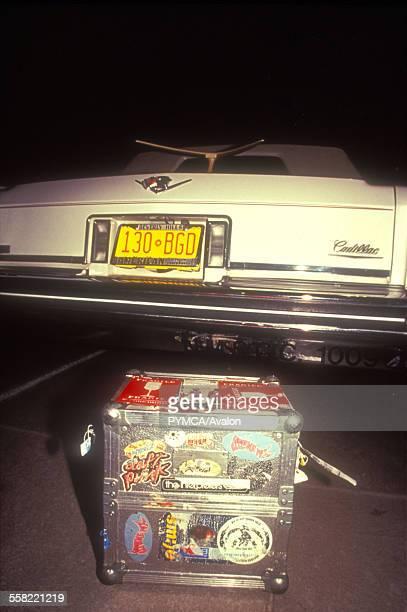 DJs Record box standing behind a white cadillac limousine Albuquerque New Mexico