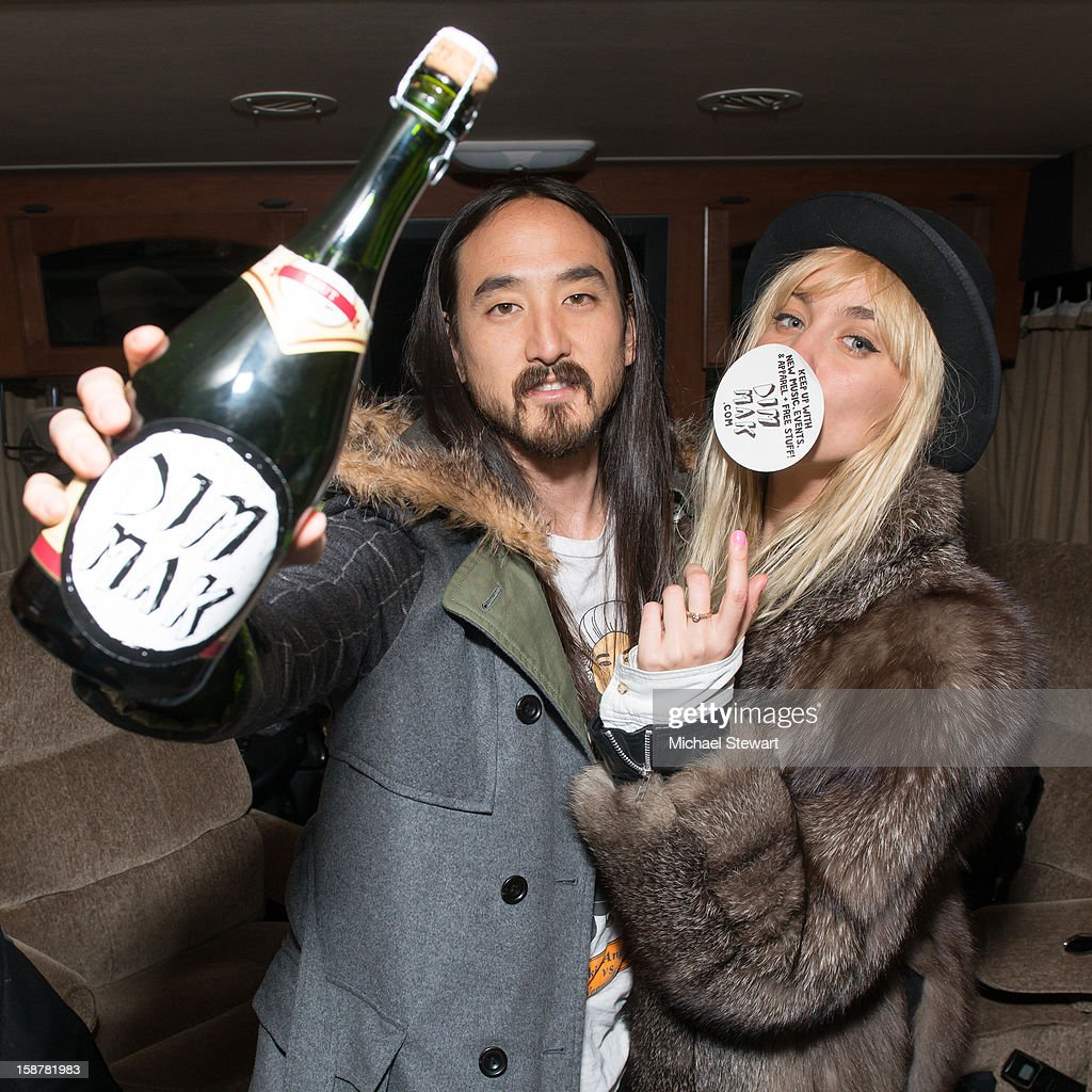 DJs <a gi-track='captionPersonalityLinkClicked' href=/galleries/search?phrase=Steve+Aoki&family=editorial&specificpeople=732001 ng-click='$event.stopPropagation()'>Steve Aoki</a> (L) and Mim Nervo attend the 2012 Aokify NYC at Pier 94 on December 27, 2012 in New York City.