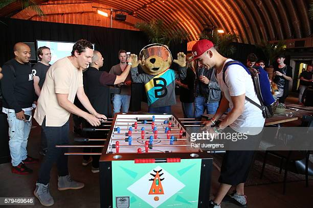 DJs Tiesto and Afrojack play foosball during the ParookaVille Festival on July 15 2016 in Weeze Germany