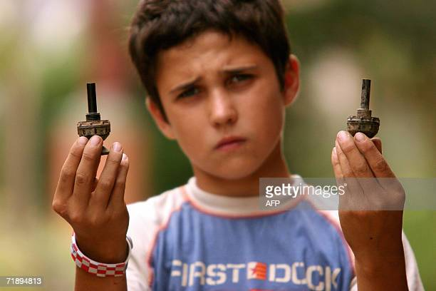 Djuka Dretvic holds antitank mines lighters 11 September 2006 found recently in front of his family house in the village of Ceric close to the...