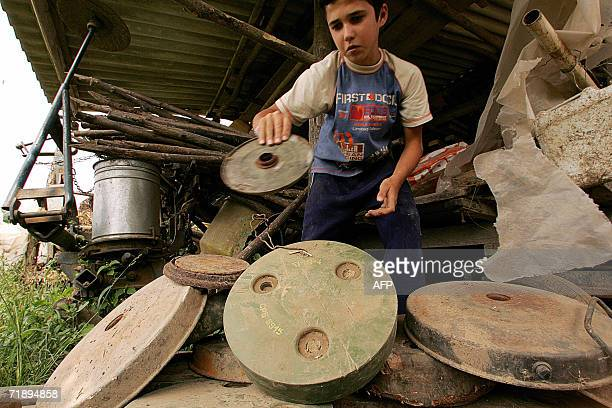 Djuka Dretvic plays with antitank landmines found recently in front of his family house in the village of Ceric close to the eastern Croatian town of...