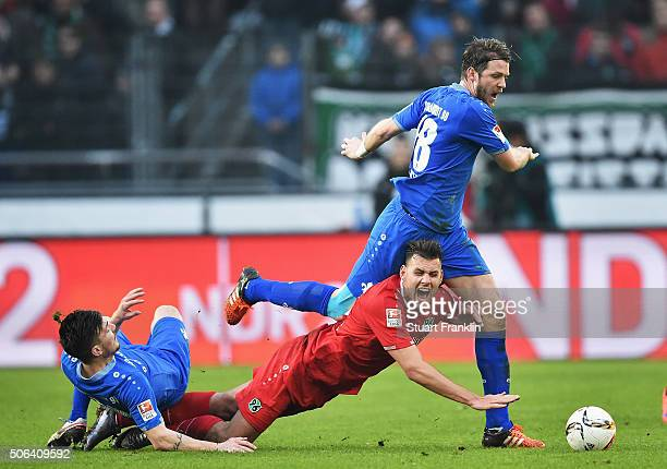 Ádám Szalai of Hannover is challenged by Peter Niemeyer of Darmstadt during the Bundesliga match between Hannover 96 and SV Darmstadt 98 at HDIArena...