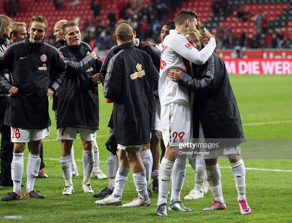 Ádám Szalai of Mainz (L) and Lewis Holtby celebrate the victory after the Bundesliga match between Bayer Leverkusen and FSV Mainz 05 at BayArena on October 24, 2010 in Leverkusen, Germany. The match between Leverkusen and Mainz ended 0-1.
