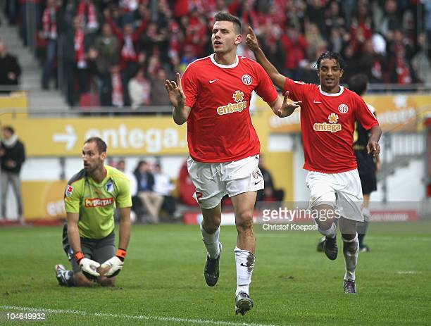 Ádám Szalai of Mainz celebrates the second goal with Sami Allagui of Mainz during the Bundesliga match between FSV Mainz 05 and 1899 Hoffenheim at...