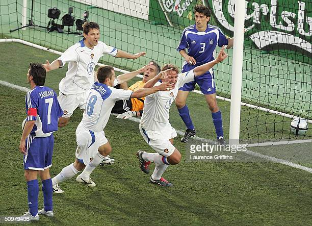 Dmitri Bulykin of Russia celebrates scoring the second goal with Dmitry Kirichenk during the UEFA Euro 2004 Group A match between Russia and Greece...