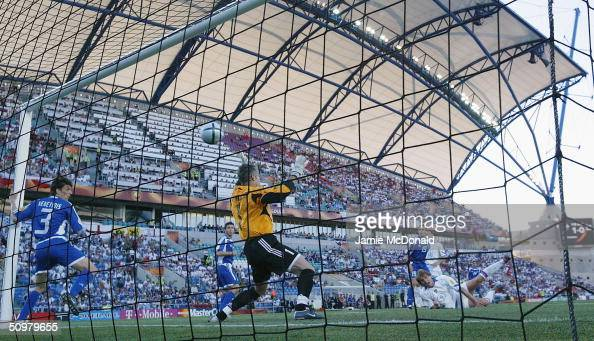 Dmitri Bulykin of Russia scores the second goal during the UEFA Euro 2004 Group A match between Russia and Greece at the Algarve Stadium on June 20...