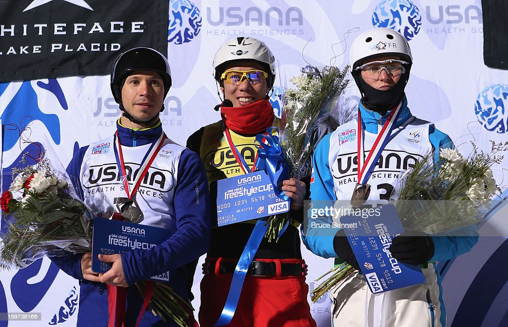 Dmitri Dashinski #7 of Belarus (third place) Zongyang Jia #1 of China (first place) and Petr Medulich #23 of Russia (third place) take the podium following the USANA Freestyle World Cup aerial competition at the Lake Placid Olympic Jumping Complex on January 19, 2013 in Lake Placid, New York.