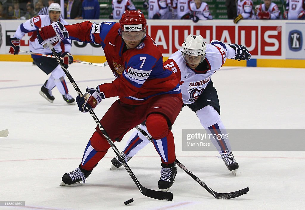 Dmitri Kalinin (L) of Russia and (R) Marcel Rodman of Slovenia battle for the puck during the IIHF World Championship group A match between Russia and Slovenia at Orange Arena on May 1, 2011 in Bratislava, Slovakia.