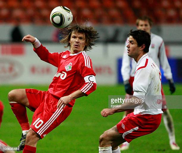 Dmitri Loskov of FC Lokomotiv Moscow battles for the ball with David Siradze of PFC Spartak Nalchik during the Russian Football League Championship...
