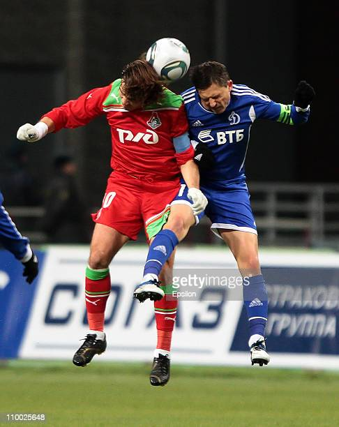 Dmitri Loskov of FC Lokomotiv Moscow battles for the ball with Igor Semshov of FC Dynamo Moscow during the Russian Football League Championship match...