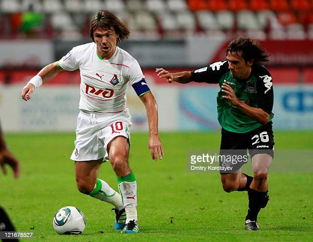 Dmitri Loskov of FC Lokomotiv Moscow battles for the ball with Marcio Abreu of FC Krasnodar during the Russian Football League Championship match...