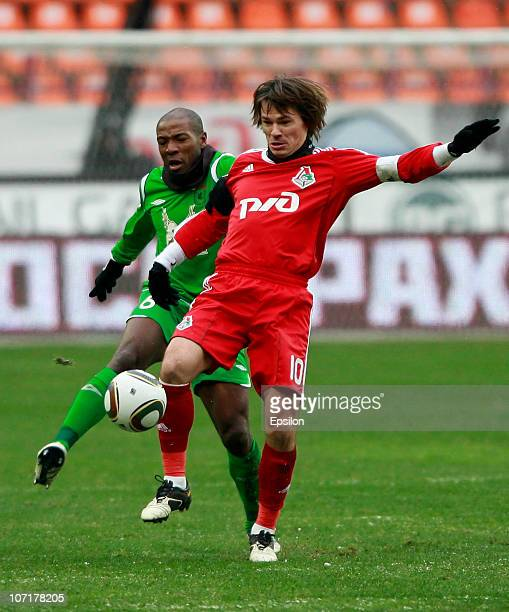 Dmitri Loskov of FC Lokomotiv Moscow in action against MacBeth Sibaya of FC Rubin Kazan during the Russian Football League Championship match between...