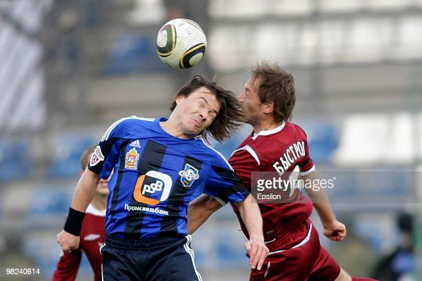 Dmitri Loskov of FC Saturn Moscow Oblast battles for the ball with Pyotr Bystrov of FC Rubin Kazan during the Russian Football League Championship...
