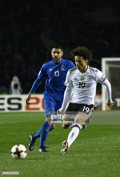 Dmitri Nazarov of Azerbaijan in action against Leroy Sane of Germany during the 2018 FIFA World Cup European Qualifying match between Azerbaijan and...