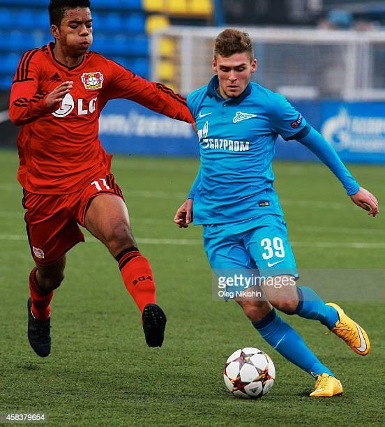 Dmitri Skopintsev of FC Zenit is challenged by Benjamin Henrichs of FC Leverkusen during the UEFA Youth League Group C match between FC Zenit St...