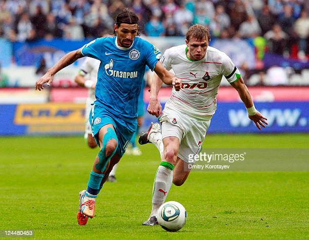 Dmitri Tarasov of FC Lokomotiv Moscow battles for the ball with Danny of FC Zenit St Petersburg during the Russian Premier League match between FC...