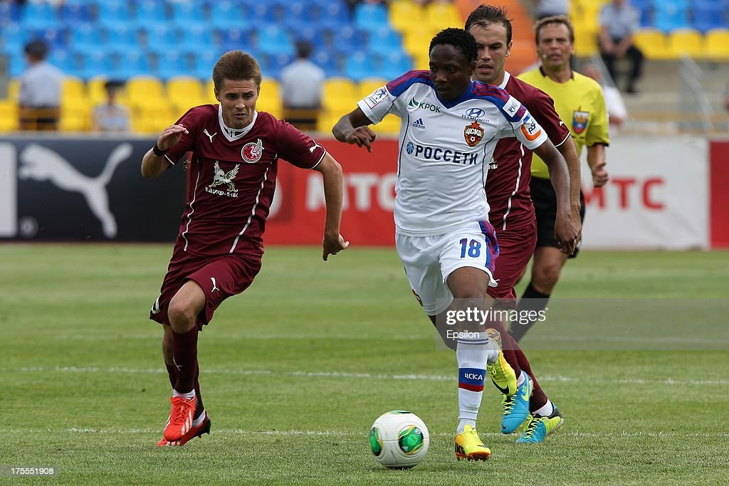 Dmitri Torbinski of FC Rubin Kazan battles for the ball with Ahmed Musa of PFC CSKA Moscow during the Russian Premier League match between PFC CSKA Moscow and FC Rubin Kazan at the Tsentralny Stadium on August 4, 2013 in Kazan, Russia.