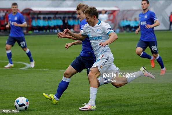 Dmitri Zhivoglyadov of FC Dynamo Moscow and Oleg Shatov of FC Zenit St Petersburg vie for the ball during the Russian Football Premier League match...