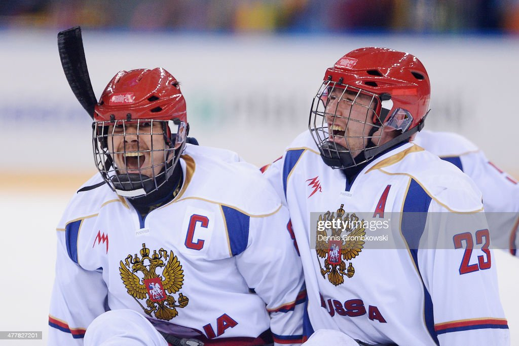 Dmitrii Lisov of Russia celebrates with team mate Ilia Volkov after the Ice Sledge Hockey Preliminary Round Group B match between the United States of America and Russia during day four of Sochi 2014 Paralympic Winter Games at Shayba Arena on March 11, 2014 in Sochi, Russia.