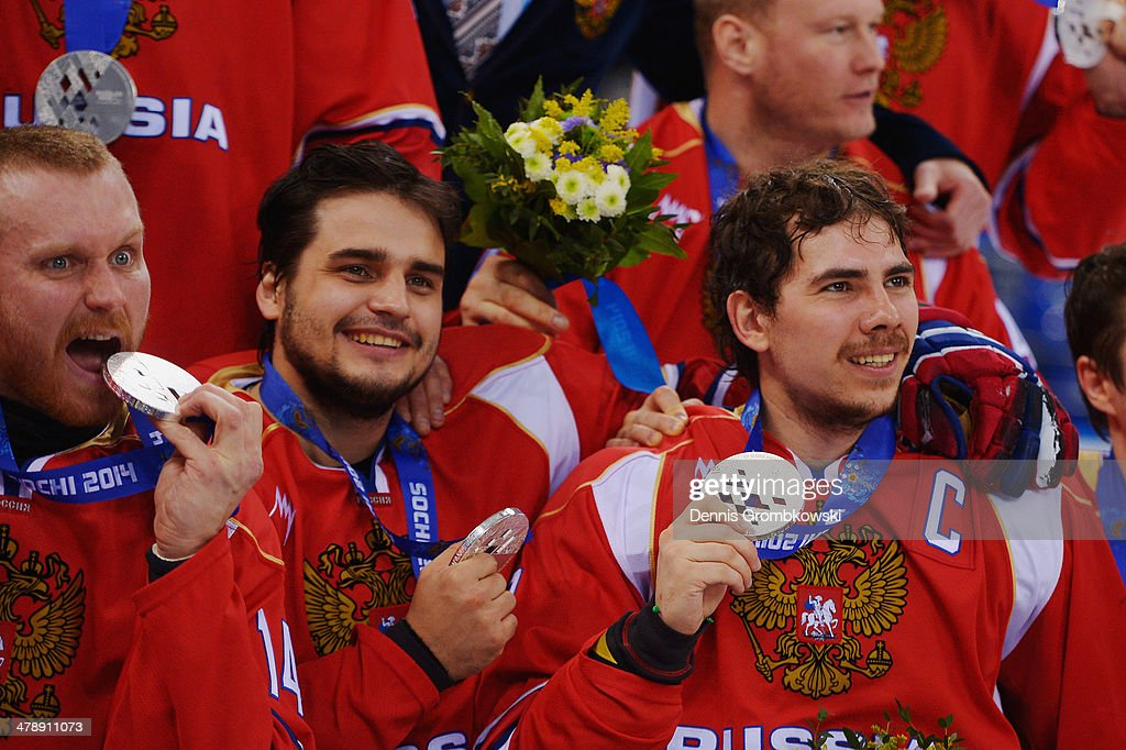 Dmitrii Lisov (R) of Russia holds his silver medal with team mates after the Ice Sledge Hockey Gold Medal game between the United States and Russia on day eight of the Sochi 2014 Paralympic Winter Games at Shayba Arena on March 15, 2014 in Sochi, Russia.