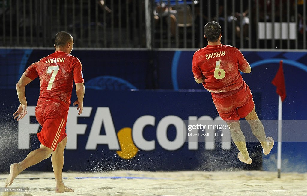Dmitrii Shishin of Russia celebrates after scoring with team mate Anton Shkarin during the FIFA Beach Soccer World Cup Tahiti 2013 Semi Final match between Russia and Tahiti at the Tahua To'ata Stadium on September 27, 2013 in Papeete, French Polynesia.