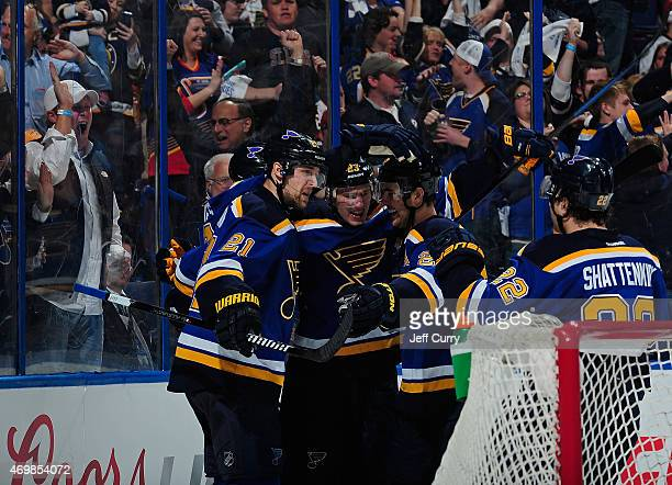 Dmitrij Jaskin of the St Louis Blues celebrates with Patrik Berglund and Alex Pietrangelo after scoring a goal against the Chicago Blackhawks on...