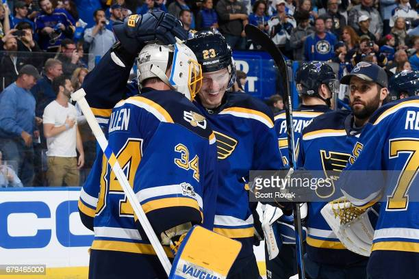 Dmitrij Jaskin of the St Louis Blues congratulates Jake Allen of the St Louis Blues after defeating the Nashville Predators in Game Five of the...