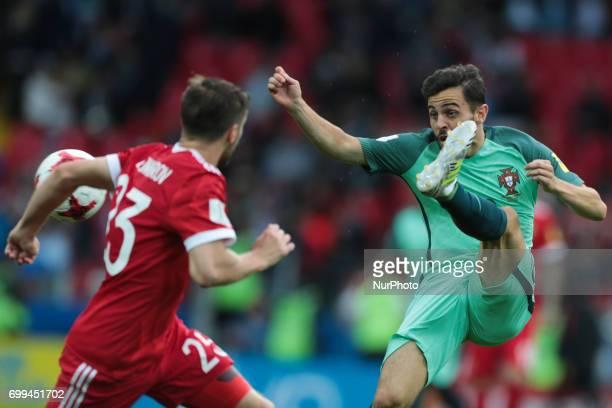 Dmitriy Kombarov of the Russian national football team and Bernardo Silva of the Portugal national football team vie for the ball during the 2017...