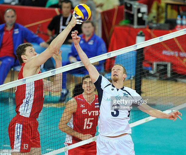 Dmitriy Muserskiy of Russia defends against Mikko Esko of Finland during the FIVB World Championships match between Finland and Russia on September...
