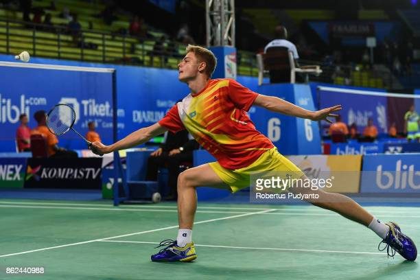 Dmitriy Panarin of Kazakhstan competes against Huang Ping Hsien of Chinese Taipei during Men Single qualification round of the BWF World Junior...