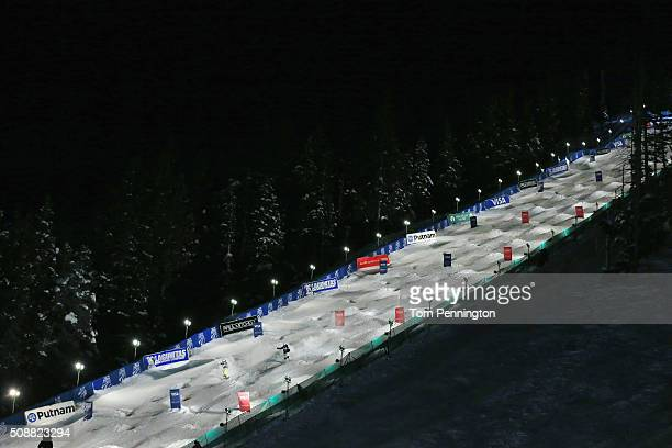 Dmitriy Reiherd of Kazakhstan competes against Philippe Marquis of Canada in the men's FIS Freestyle Skiing Dual Moguls World Cup at Deer Valley...