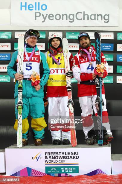 Dmitriy Reiherd of Kazakhstan Mikael Kingsbury of Canada and Philippe Marquis of Canada celebrate on the podium following the FIS Freestyle Ski World...