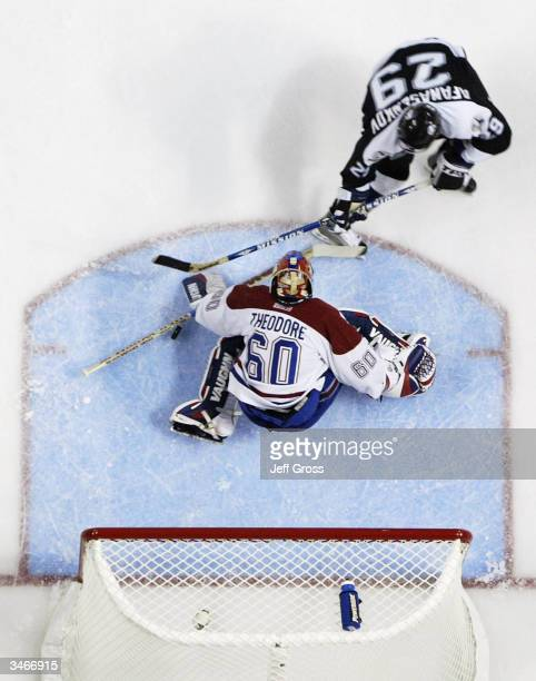 Dmitry Afanasenkov of the Tampa Bay Lightning is stopped by goaltender Jose Theodore of the Montreal Canadiens on a break away during game two of the...