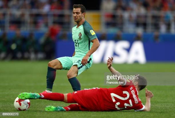 Dmitry Kombarov of Russia attempts to tackle Cedric of Portugal during the FIFA Confederations Cup Russia 2017 Group A match between Russia and...