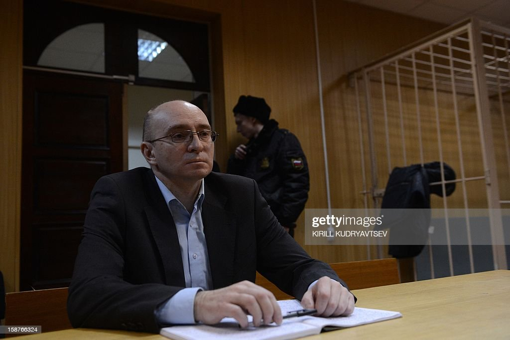 Dmitry Kratov, the prison official accused of causing the death of lawyer Sergei Magnitsky in prison in 2009, sits in a courtroom during his trial in Moscow on December 28, 2012. Moscow court is to deliver today verdict in trial of Dmitry Kratov. Earlier this week prosecutors moved to drop charges against him.