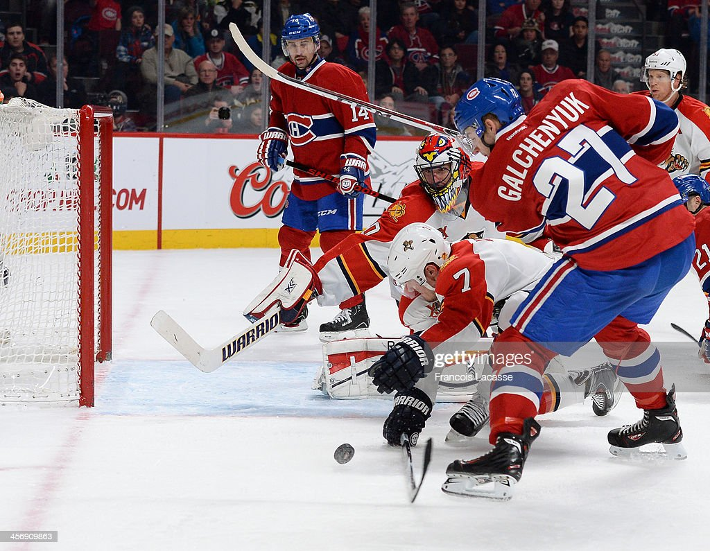 Dmitry Kulikov #7 and <a gi-track='captionPersonalityLinkClicked' href=/galleries/search?phrase=Scott+Clemmensen&family=editorial&specificpeople=214674 ng-click='$event.stopPropagation()'>Scott Clemmensen</a> #30 of the Florida Panthers, defend the goal against <a gi-track='captionPersonalityLinkClicked' href=/galleries/search?phrase=Alex+Galchenyuk&family=editorial&specificpeople=7419137 ng-click='$event.stopPropagation()'>Alex Galchenyuk</a> #27 of the Montreal Canadiens during the NHL game on December 15, 2013 at the Bell Centre in Montreal, Quebec, Canada.