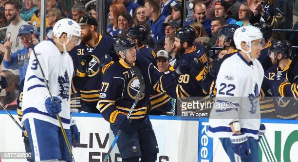 Dmitry Kulikov of the Buffalo Sabres celebrates his second period goal while Alexey Marchenko and Nikita Zaitsev of the Toronto Maple Leafs skate to...