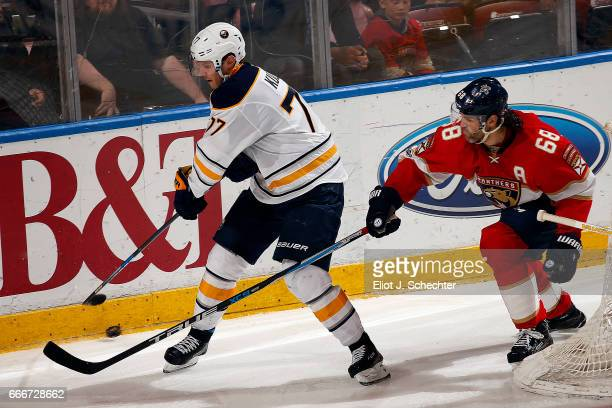 Dmitry Kulikov of the Buffalo Sabres tangles with Jaromir Jagr of the Florida Panthers at the BBT Center on April 8 2017 in Sunrise Florida